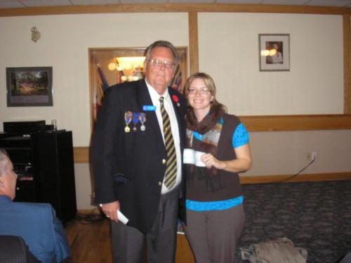Cam Wortman Poppy Chairmam presents cheque - Nov 2011